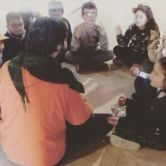 Paolo teaching meditation to children
