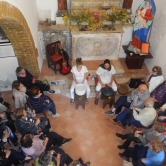 Amy & Paolo teaching meditation and relaxation in the church in Borgo Pantano